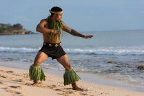 Male dancer performing at beach in soft light — Stock Photo