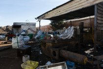Compressed trash in scrapyard on a sunny day — Stock Photo
