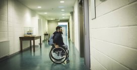 Handicapped man on wheelchair waiting for elevator indoors — Stock Photo