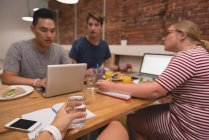 Executives discussing with each other in the creative office — Stock Photo