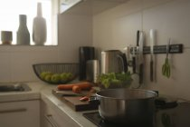 Pan on induction cooktop in kitchen at home — Stock Photo