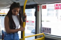 Thoughtful teenage girl travelling in the bus — Stock Photo