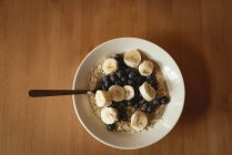Closeup overhead view of breakfast on wooden table — Stock Photo