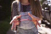 Mid section of girl playing string game with hands. — Stock Photo