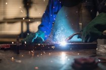 Female welder using welding torch in workshop. — Stock Photo