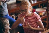 Girl in glasses having a snack at home — Stock Photo