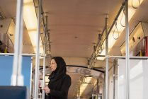 Thoughtful woman in hijab travelling in train — Stock Photo