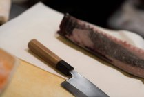 Japanese deba knife kept on kitchen table in a restaurant — Stock Photo