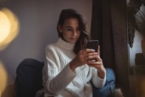 Beautiful woman taking taking a selfie at home — Stock Photo