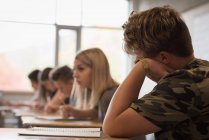 Attentive university students studying in classroom — Stock Photo