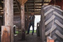 Tire part of framer tractor with chain in garage — Stock Photo