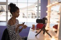 Beautiful fashion blogger make video blog with digital camera — Stock Photo