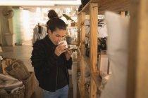 Beautiful woman drinking milk in coffee shop — Stock Photo