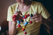 Cropped image of girl experimenting with molecule at home — Stock Photo