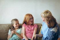 Mother and kids having fun in living room at home — Stock Photo