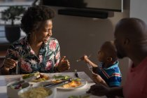 Family with having dinner at table at home. — Stock Photo