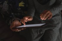 Mid section of Muslim mother and daughter using digital tablet — Stock Photo