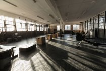 Interior view of fitness studio with equipment in sunlight. — Stock Photo