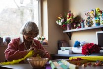Senior woman doing craft work at nursing home — Stock Photo