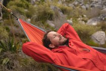 Close-up of hiker relaxing in hammock on a sunny day — Stock Photo