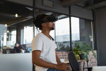 Man experiencing virtual reality headset in office. — Stock Photo