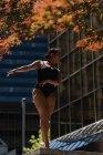 Female ballet dancer dancing in the city — Stock Photo