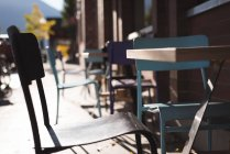 Empty chair at outdoor cafe on a sunny day — Stock Photo