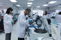 Team of laboratory technicians working together in blood bank — Stock Photo