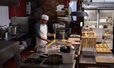 Male baker preparing for making pasta — Stock Photo