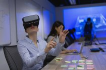 Businesswoman using virtual reality headset in conference room at office — Stock Photo