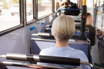 Rear view of woman travelling in modern bus — Stock Photo