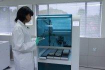 Laboratory technician using digital tablet in blood bank — Stock Photo