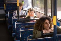 Young woman travelling in modern bus — Stock Photo