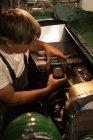Male mechanic servicing a car in garage — Stock Photo