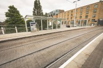 Empty platform and railway track at railway station — Stock Photo