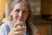 Close-up of senior woman having wine at home — Stock Photo