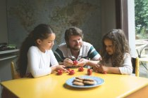 Father with his daughters playing with toys at home — Stock Photo