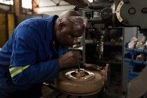 Attentive blacksmith working in workshop — Stock Photo