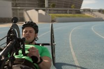 Disabled athlete racing in wheelchair on a racing track — Stock Photo