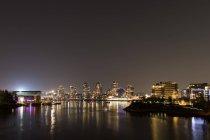 Modern metropolitan city with waterfront — Stock Photo