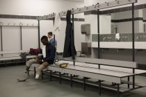 Two disabled athlete relaxing together in changing room — Stock Photo