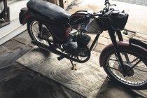 Motorbike standing in repair garage — Stock Photo