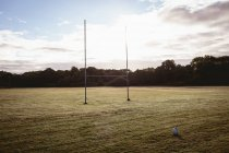Empty rugby ball and goal post in the field — Stock Photo