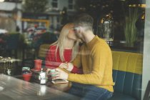 Romantic couple kissing in cafeteria — Stock Photo