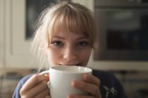Close-up of woman having coffee at home — Stock Photo