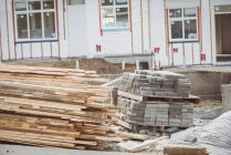 Stack of wooden planks at construction site — Stock Photo