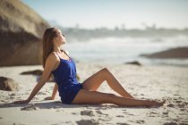 Beautiful woman relaxing on beach on a sunny day — Stock Photo