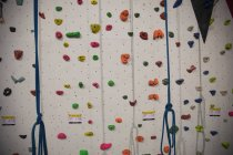 Artificial climbing wall in gym for practice — Stock Photo