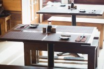 Empty dining tables and benches in restaurant — Stock Photo
