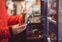 Close-up of man selecting ski goggles in a shop — Stock Photo